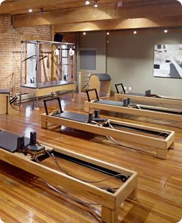 Pilates Cadillac and Pilates Reformer Equipment in a beautiful setting.