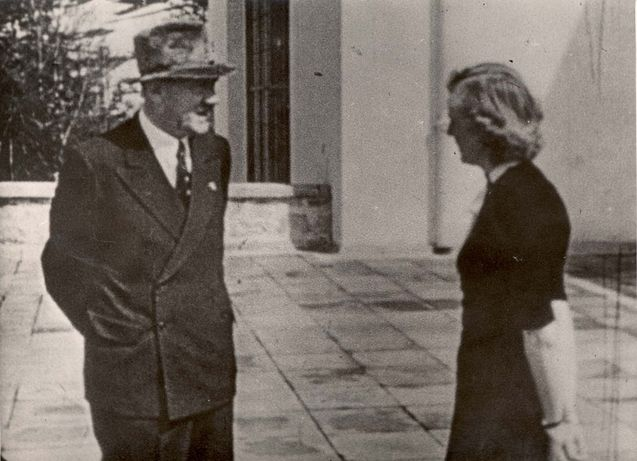 Berghof, Germany, Hitler and Eva Braun, talking.