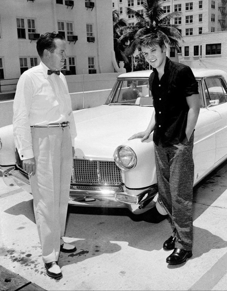 Already a millionaire at the age of 21, a youthful looking Elvis Presley poses with Miami Lincoln Mercury dealer Lade Conlee and his new Continental Mark II during the summer of 1956.   Elvis' lavender Lincoln was covered with love notes written in lipstick by fans. He turned it in for a new car, the new car was valued $10,000.00 and provided a nice addition to his three remaining Cadillacs at home in Memphis.