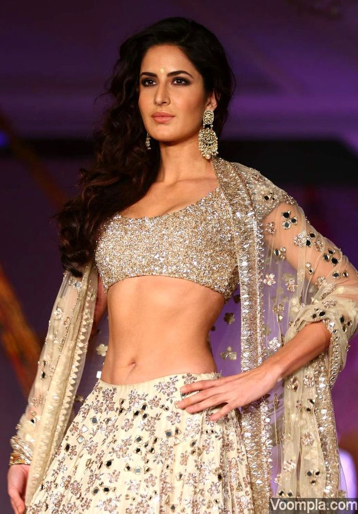 Katrina Kaif sizzles in a traditional look comprising of a designer low cut blouse and white lehenga choli by Manish Malhotra. via Voompla.com