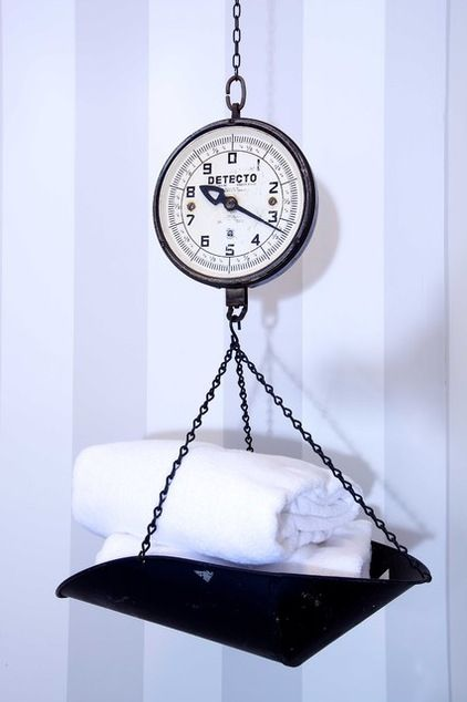 Repurposing applies to more than just furniture. Think accessories like this old scale used as a towel holder. It could also function in the...