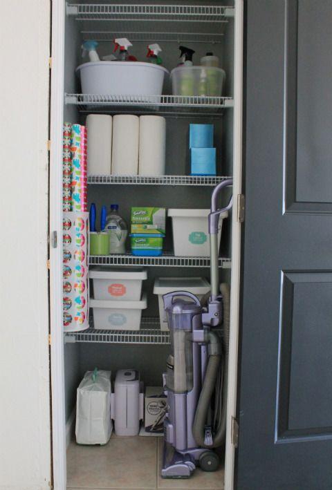 Coat closet turned utility closet - Ikea plastic bag holder = wrapping paper holder!