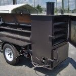 Trailer with a BBQ smoker grill on.