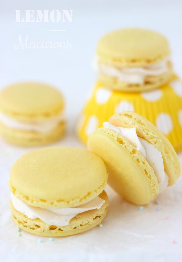 Spring is in the air! Celebrate with these tender lemon macarons- they are sweet, tangy and vibrant to excite the air of SPRING! #macarons #lemon