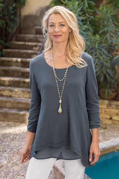 Two fabrics team up to create our Marseille Tunic. Soft jersey knit with a tonal georgette tank underneath create a flowy silhouette, with just the right amount of shape.