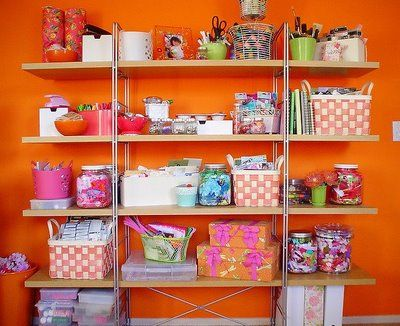 Love this fun color scheme... putting a little method to the craft-madness with the baskets and bins