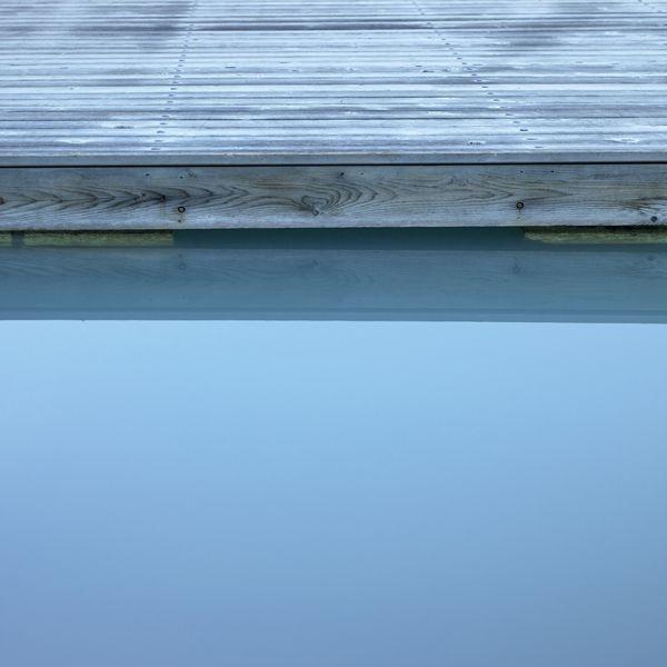 Melissa Mercier's Irrational Fear Of Confined Spaces 1. #art #photography #water #blue #dock #calming #opaque #image #photograph #auction #artsumbrella #vancouver