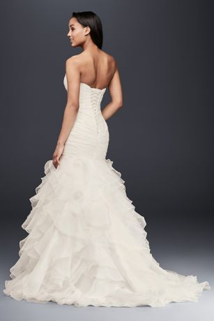 """Precise pleats and romantic ruffles offer a contrast of texture and technique on this curve-hugging organza extra lengthmermaid gown. The lace-up back ensures a perfect fit.   David's Bridal Collection  4"""" extra length  Polyester  Sweep train  Lace-up back; fully lined  Dry clean  Imported  Also available in regular, plus size ,petite , plus size extra length"""