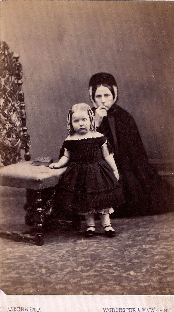 What an artistically composed photo this is of a woman and daughter documenting their mourning.