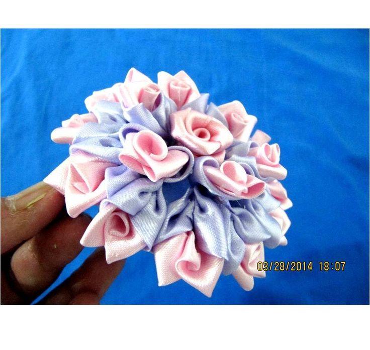 Flores rosas lilas kanzashi en cintas para el cabello