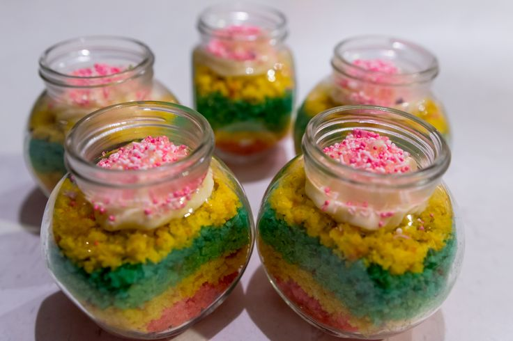 Deconstructed Rainbow Cake in a Jar-to-Go: Rainbow vanilla cupcakes, buttercream filling and topping with Princess sprinkles.