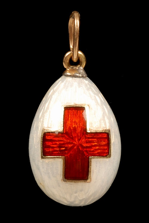 A Faberge Red Cross Egg pendant 1915. Empress Alexandra Feodorovna and her two eldest daughters, Olga and Tatiana, trained as Red Cross nurses in World War I.