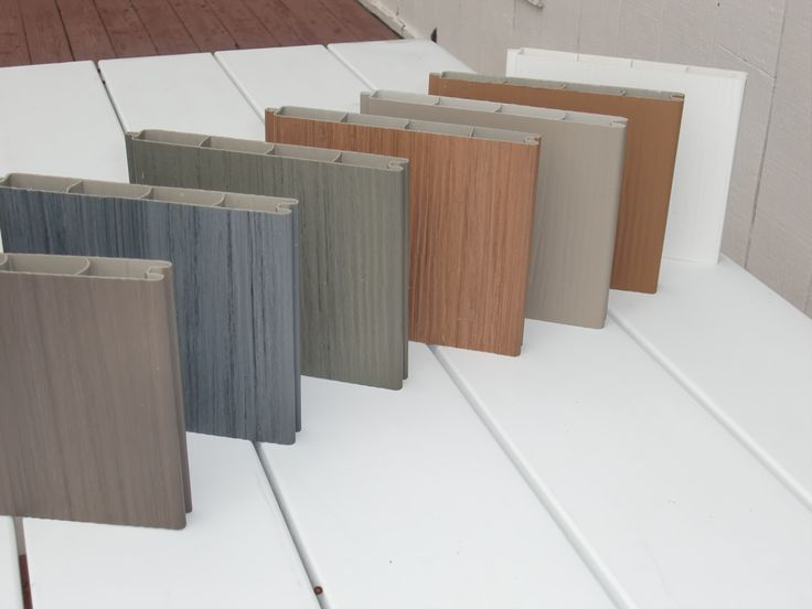 Vinyl fence samples with wood grain look.  Multiple colors make it look very realistic yet, virtually maintenance free!