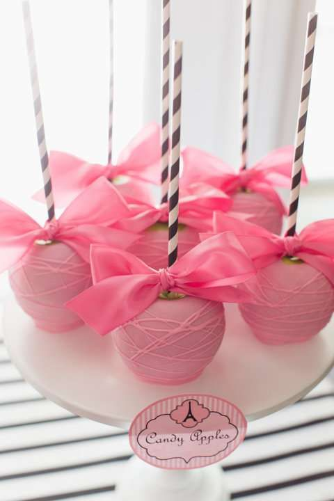 Pink candy apples at a Paris poodle birthday party! See more party planning ideas at CatchMyParty.com!