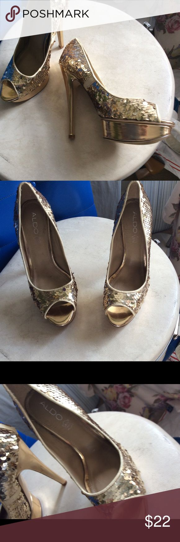 """Gold sequin peep toe pumps mermaid sequin pattern. ALDO GOLD SEQUIN PEEP OPEN TOE WOMEN'S HIGH HEEL PLATFORM   These are used but in excellent condition, these shoes look ultra glamorous.  Platform is 1"""" tall Heels are about 6"""" tall Size 38 Europe size Measurements: approx. 9 3/4"""" long inside, 2 3/4"""" wide outsoles, 6"""" heels Aldo Shoes Platforms"""