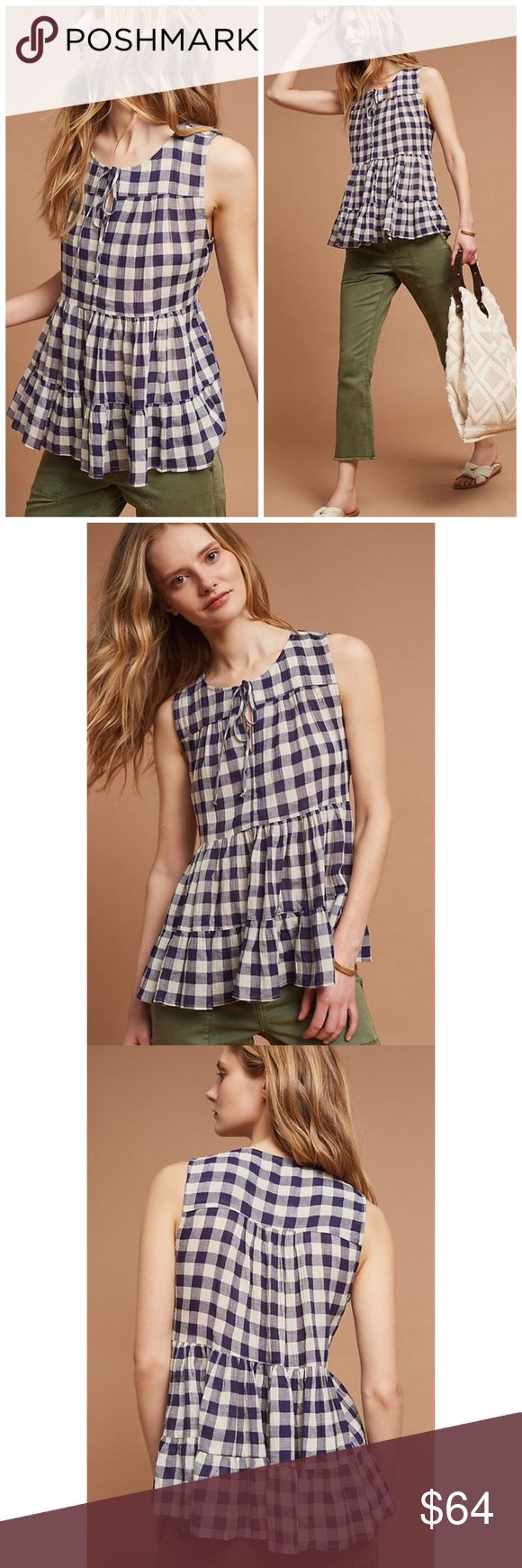 """Anthropologie Tylho Skirted Gingham Peplum Top Details:  This ruffled top features an on-trend gingham print that's layer ready for fall. From Tylho. •Size: Medium •Color: Navy Gingham •Original Retail Price: $78 •Cotton, linen ◦Peplum silhouette ◦Tie-neck detail ◦Pullover styling ◦Hand wash ◦Imported •Style No. 4110392640002  Dimensions •Regular: 26""""L Anthropologie Tops"""