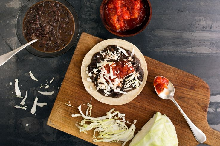 Canned black beans and lots of cabbage combine in a quick, utterly satisfying one-dish taco dinner They can be served open-faced or folded over