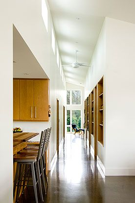 County Trail House - the 80 foot long corridor runs east west from the front door to the study creating a spine of natural light lined with art work and book selves.