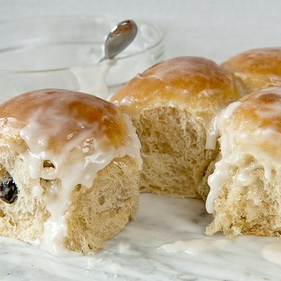 A favorite dinner roll recipe gets a makeover to produce these sweet yeast rolls. Rum icing (using rum or rum extract) and raisins are the stars of the show.