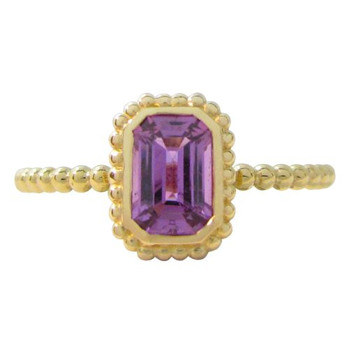 THE TESSA RING WITH PURPLE SAPPHIRE  This lovely radiant cut purple sapphire weighs .63ct and is nestled in a 18kt yellow gold granulated Tessa ring setting. This purple sapphire ring is a size 6 which can also be sized. (R65718Y)