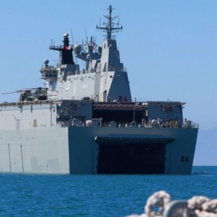 Engineers are frantically working to solve engine problems on the Royal Australian Navy's two largest ships, with fears the Landing Helicopter Docks could be out of action for several weeks.