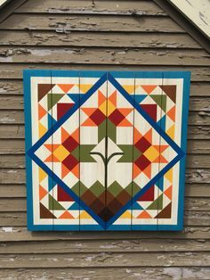 This website has a photo gallery of 67 barn quilt block designs.
