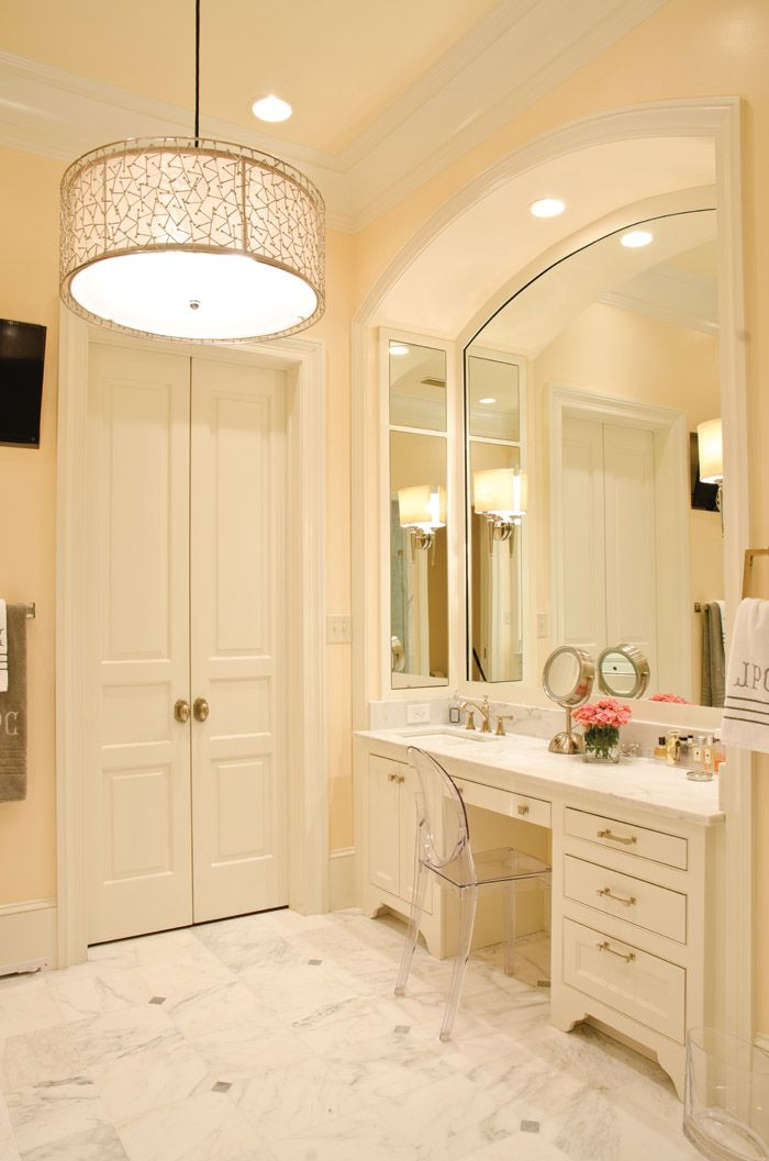 Marble bathroom with lucite vanity chair.