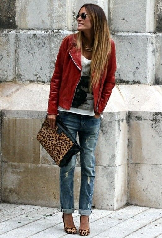 A red leather moto jacket and blue destroyed boyfriend jeans will convey a carefree, cool-girl vibe. A cool pair of tan leopard suede pumps is an easy way to upgrade your look.  Shop this look for $210:  http://lookastic.com/women/looks/sunglasses-necklace-biker-jacket-crew-neck-t-shirt-clutch-boyfriend-jeans-pumps/4855  — Black Sunglasses  — Gold Necklace  — Red Leather Biker Jacket  — White and Black Print Crew-neck T-shirt  — Brown Leopard Leather Clutch  — Blue Ripped Boyfriend Jeans  —…