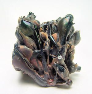 Shiny black molten fulgurite glass (exogenic fulgurites) thrown into the air, form as a result of the expanding, superheated gases produced by a lightning strike.