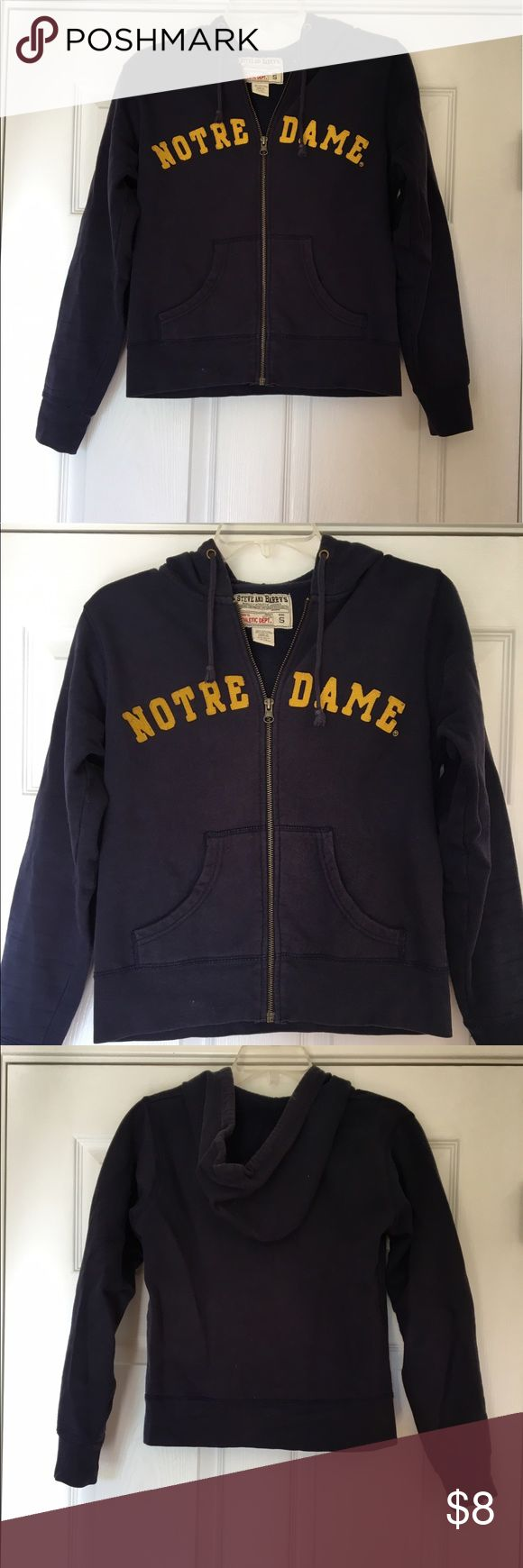 Notes Dame zip up hoodie Solid navy zip up hoodie with yellow stitched on letters. Size small, but fits more like a XS. Slight fading noticed throughout navy due to previous washings. No holes or rips noted! Steve & Barry's Tops Sweatshirts & Hoodies