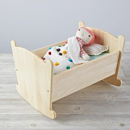 Every little doll will look forward to naptime when they're rocked to sleep in our Nod Doll Cradle and Bedding Set. It's made from solid wood and coordinates nicely with your little one's small-sized friends.
