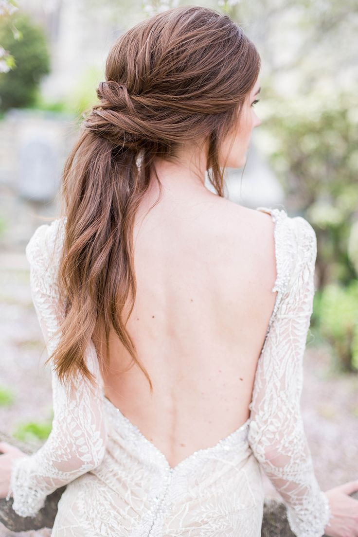 Gorgeous twisted ponytail updo & a low-back beaded gown: www.stylemepretty... | Photography: Sally Pinera - www.sallypinera.com/