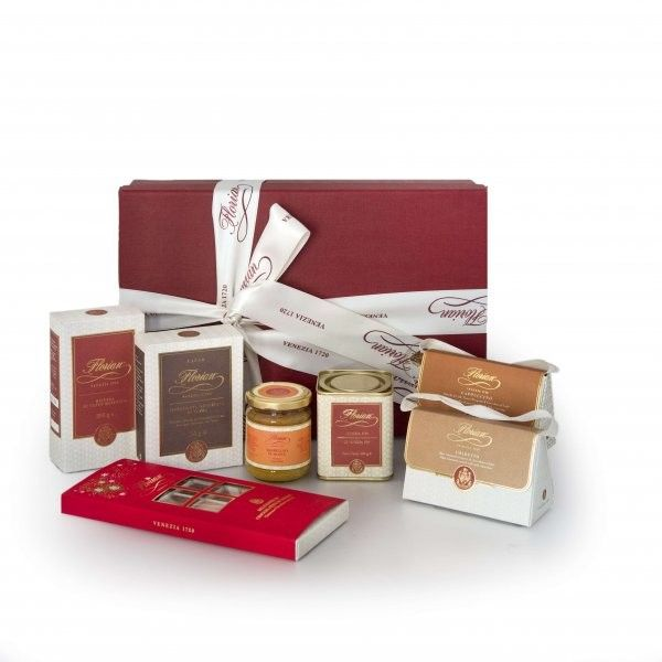 """Florian Collection The historic Venetian coffeehouse meets the taste, elegance and refinement of the real gourmet products, strictly made in Italy.  The hamper includes:  - 1 Florian """"Venezia 1720"""" blend roasted ground coffee 250 gr  - 1 Cappuccino dragées 50 gr, 1 Amaretto dragées 50 gr  - 1 Florian fine dark chocolate hot cocoa 100 gr  - 1 Florian Venezia 1720 tea - loose in tin 100 gr  - 1 Florian orange extra jam 120 gr  - 1 Florian classic chocolate selection 150 gr"""
