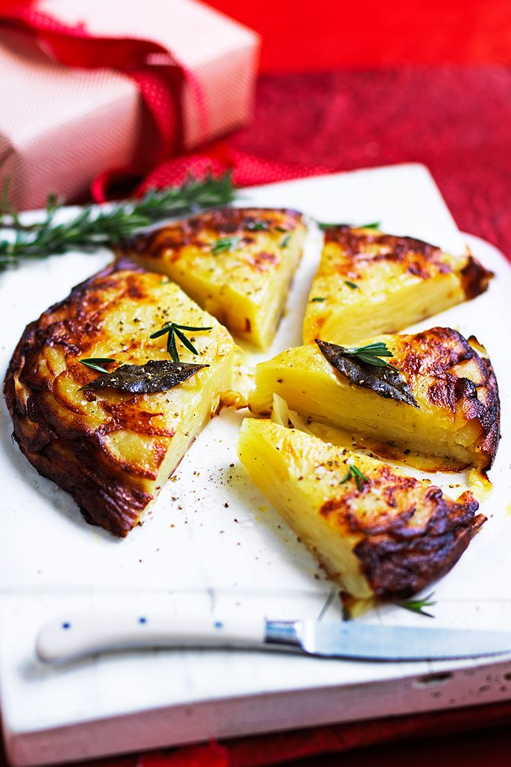 Thin slices of potato are layered with lashings of brandy butter and baked to golden perfection for a Christmas-inspired side dish that pairs wonderfully with both meat and vegetarian mains.