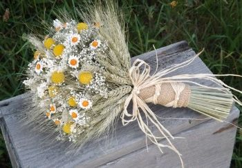 A wheat bouquet with dried mums, baby's breath and chamomile flowers.
