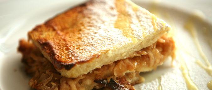 Traditional Czech Žemlovka: Apple Bread Pie with Quark and Raisins, Prague - Czech Republic