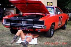 Daisy Duke on her back for The General Lee