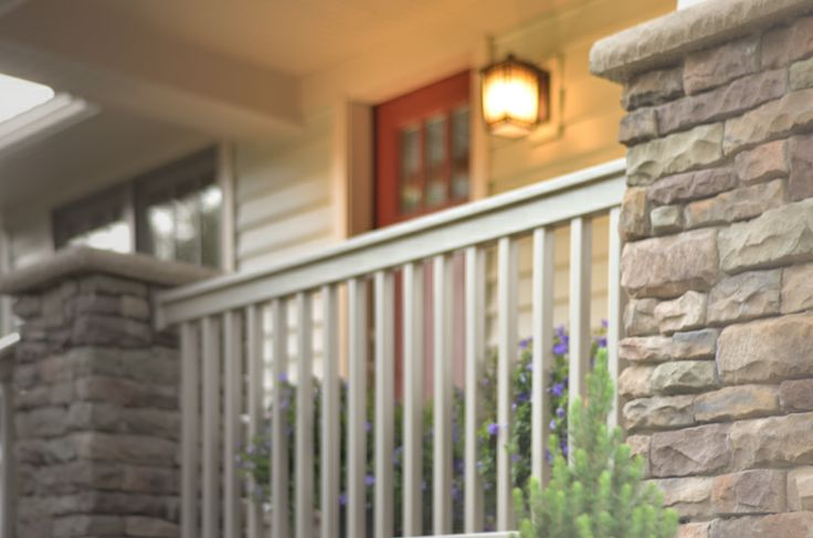 Combine stone with rail and it creates a classic front porch you want to drink your morning coffee on.