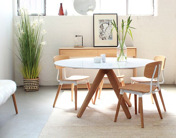 Australian designed. Our Round Marble Dining Table is an exquisite dining table ideal for residential use. Featuring beautiful Oak Legs with Copper detail and a