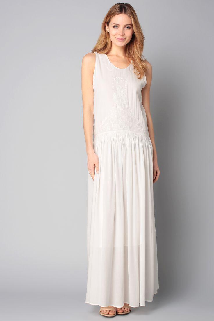 Veste pour aller avec robe blanche