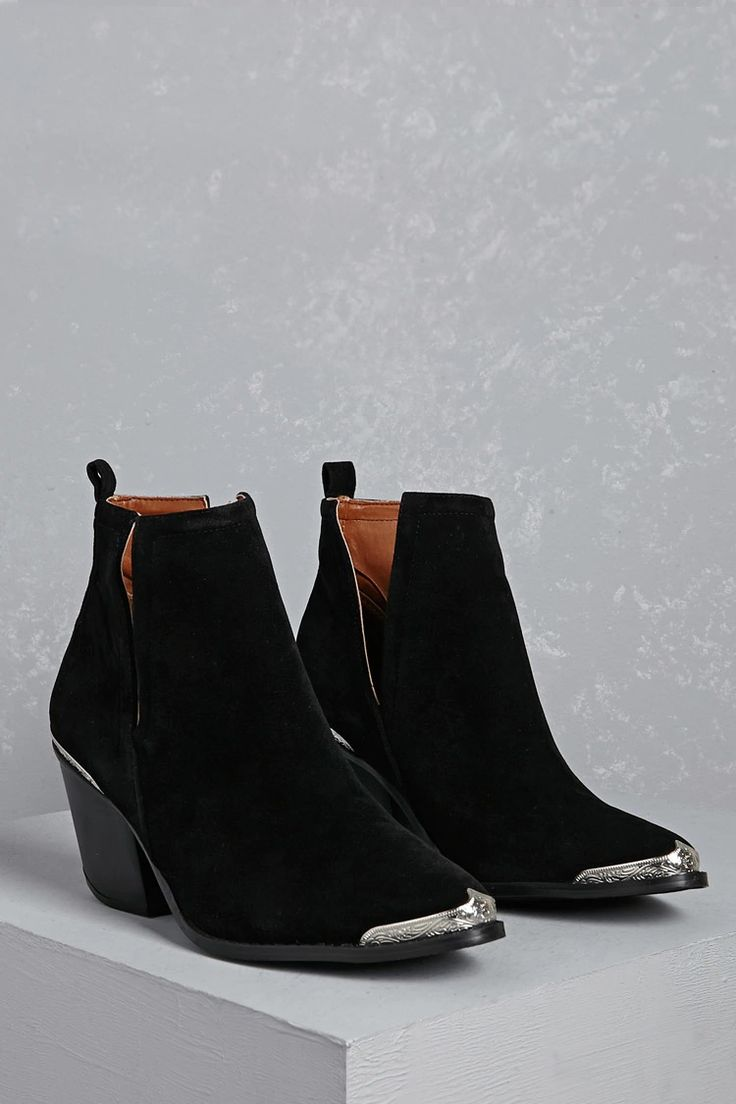 A pair of faux suede ankle boots featuring Western-inspired etched toe and heel caps, side slits, and a stacked block heel.<p>- This is an independent brand and not a Forever 21 branded item.</p>