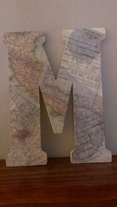 Another anniversary gift I made for my husband. Wooden letter from hobby lobby. Mod podged on top is a transparent copy of our wedding certificate and a map of Rome (where we were married).