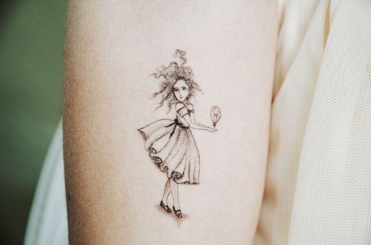 """""""Little Girl with a Big Idea.""""  She got it because, """"this tattoo is to remind me to always have a childlike sense of wonder and keep creating!"""""""