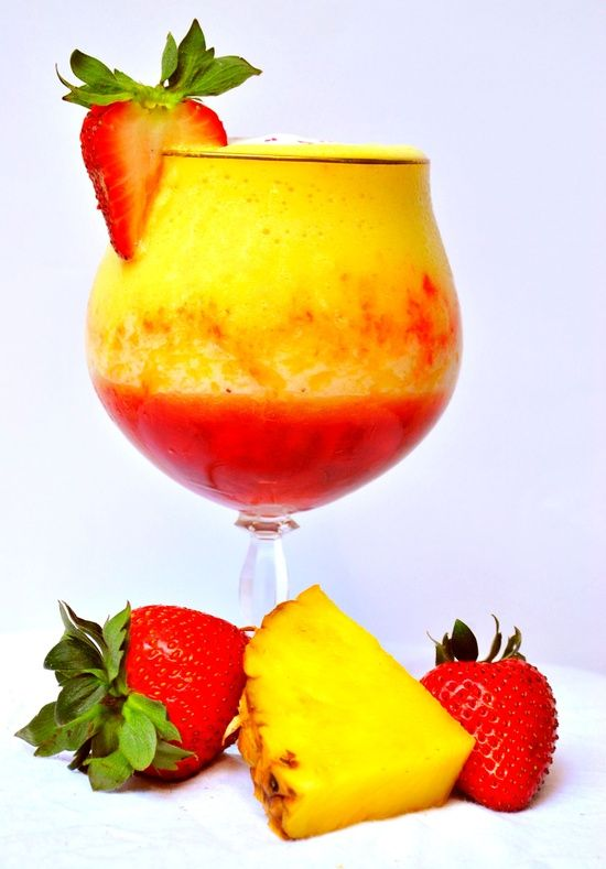 Pineapple Upside Down Cake Daiquiri - 1 cup frozen pineapple chunks, 2 strawberries, 2 splashes coconut sparkling water, crushed ice cubes, 1oz whipped cream vodka, 1/2 oz pineapple rum. Spoon mashed strawberries into bottom of glass, blend rest of the ingredients and pour over strawberries. Enjoy!.