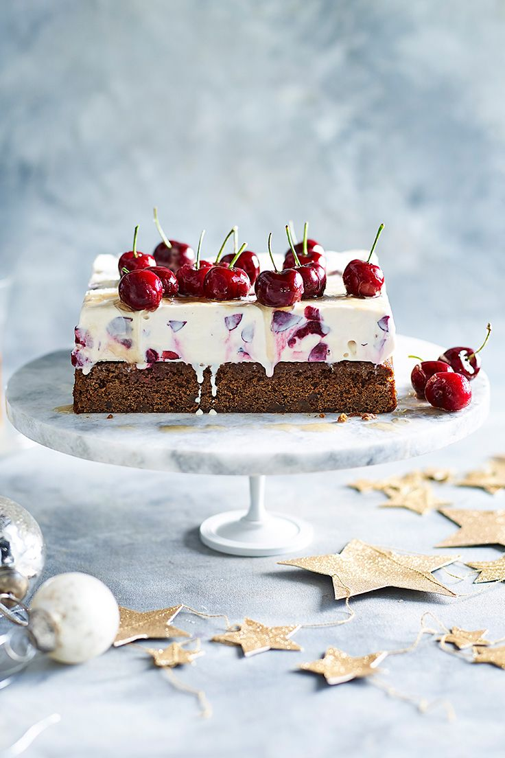 Traditional Christmas flavours are given a decadent update and a distinctly Australian twist in this cherry and ginger ice-cream cake. Topped with brandied cherries, it's sure to be the talk of the town.