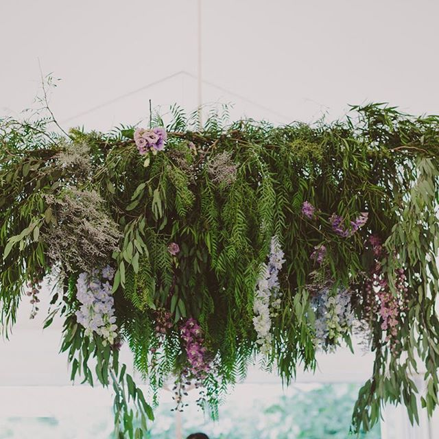 Suspended floral installation with greenery galore