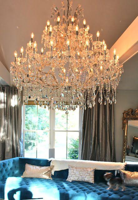 Modern Turquoise Blue Velvet Chesterfield Sofa Oversized Crystal Chandelier Gray Silk Curtains Ornate