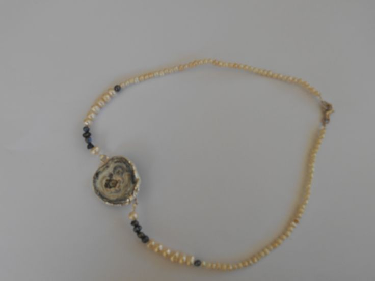 Pearls, silver 925o and achate in the center for a very beautiful necklace@@