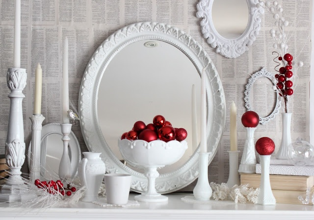 A white Christmas mantel with pops of red. love!