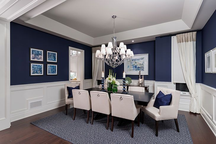 What a luxurious #dining #room design. Love the wall color, the elegant chandelier, and the perfect table setting and furniture.